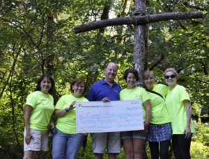 Pacific Northwest Region Financial Consultant, Rick Brathovde, presents a check for $20,000 to Camp Lutherwood Oregon Staff on August 9, 2013.