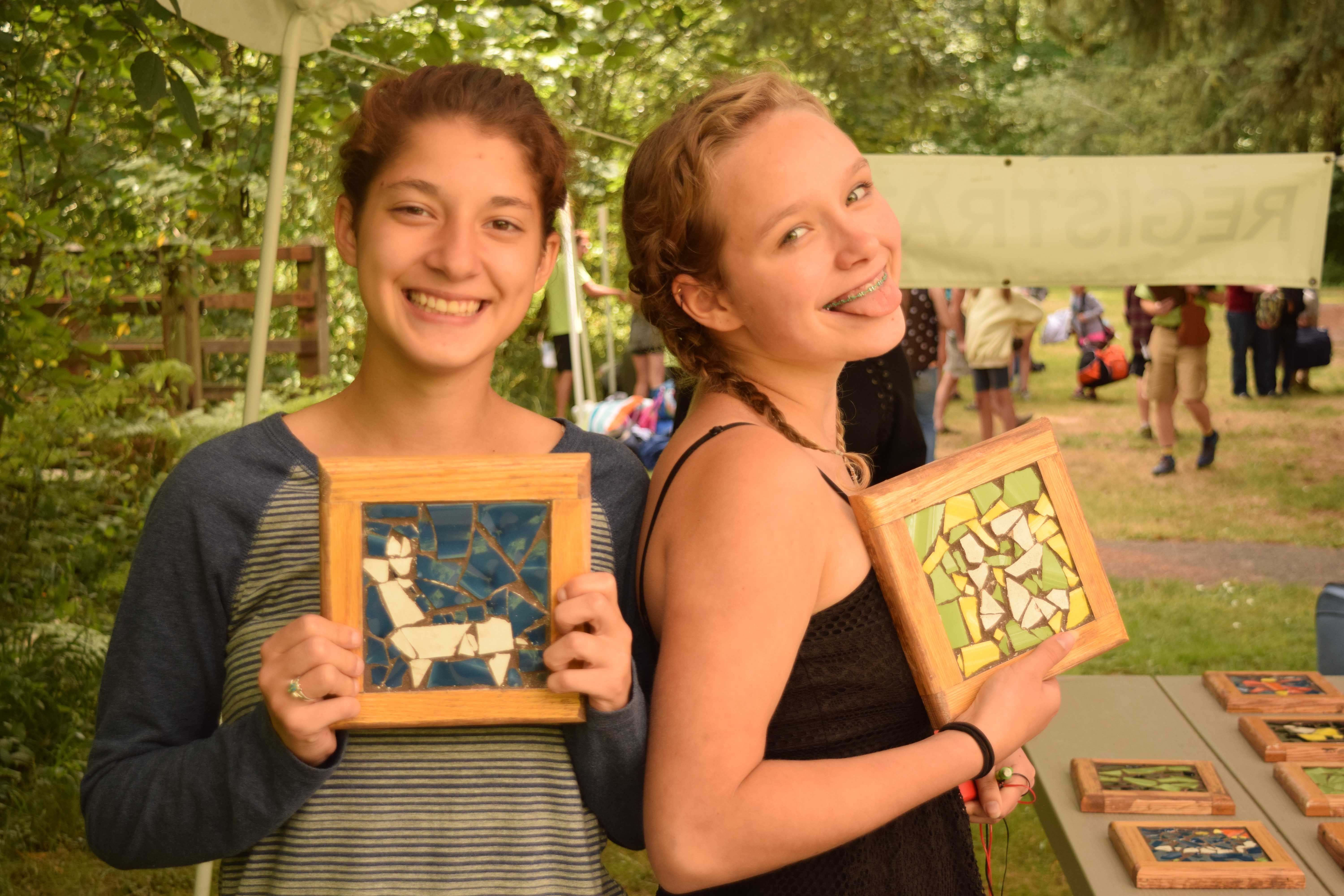Jade and CeCe proudly show off their mosaics