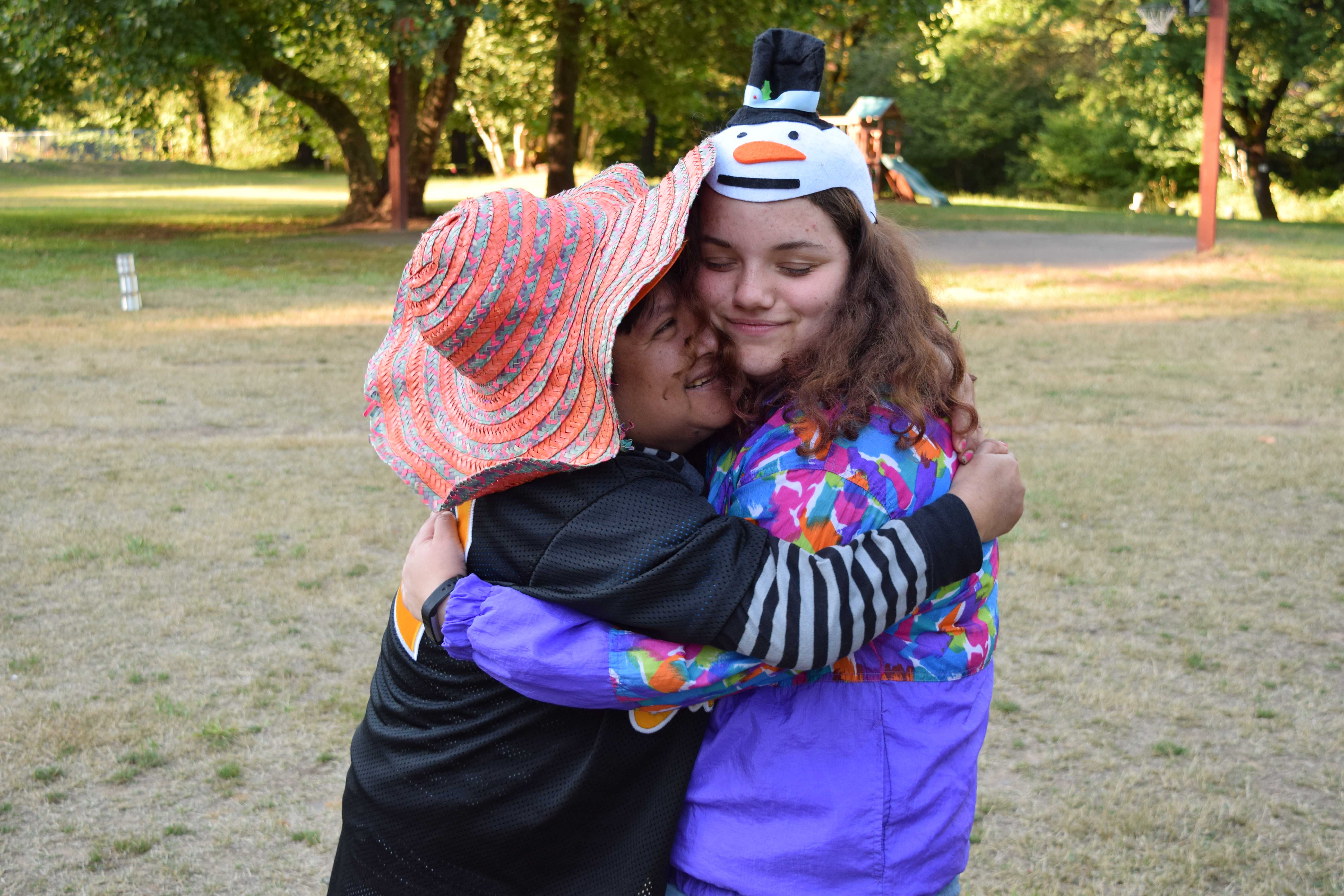 Berta and Becca hug during the costume dance party.
