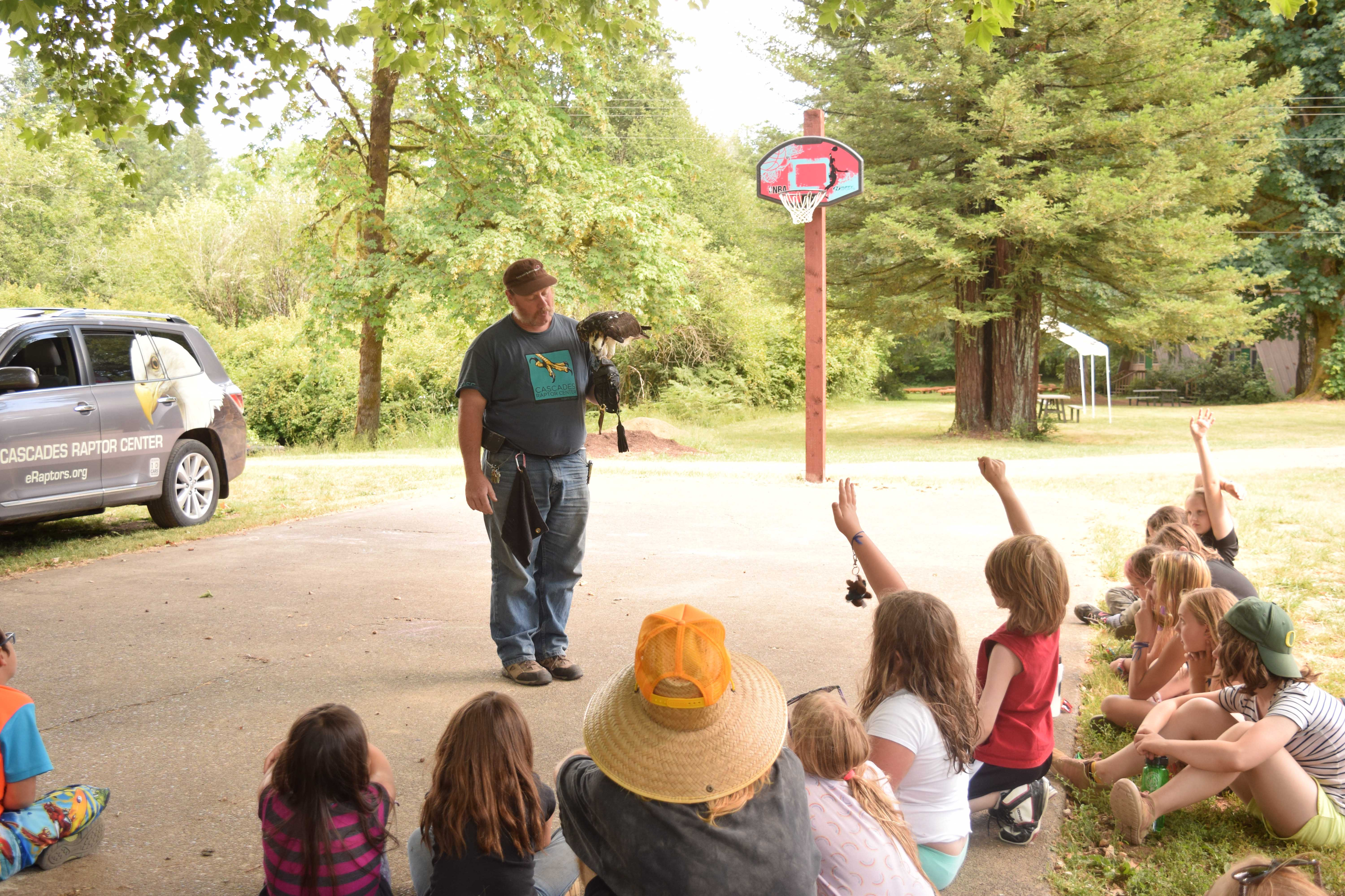 Campers ask questions about the raptor.