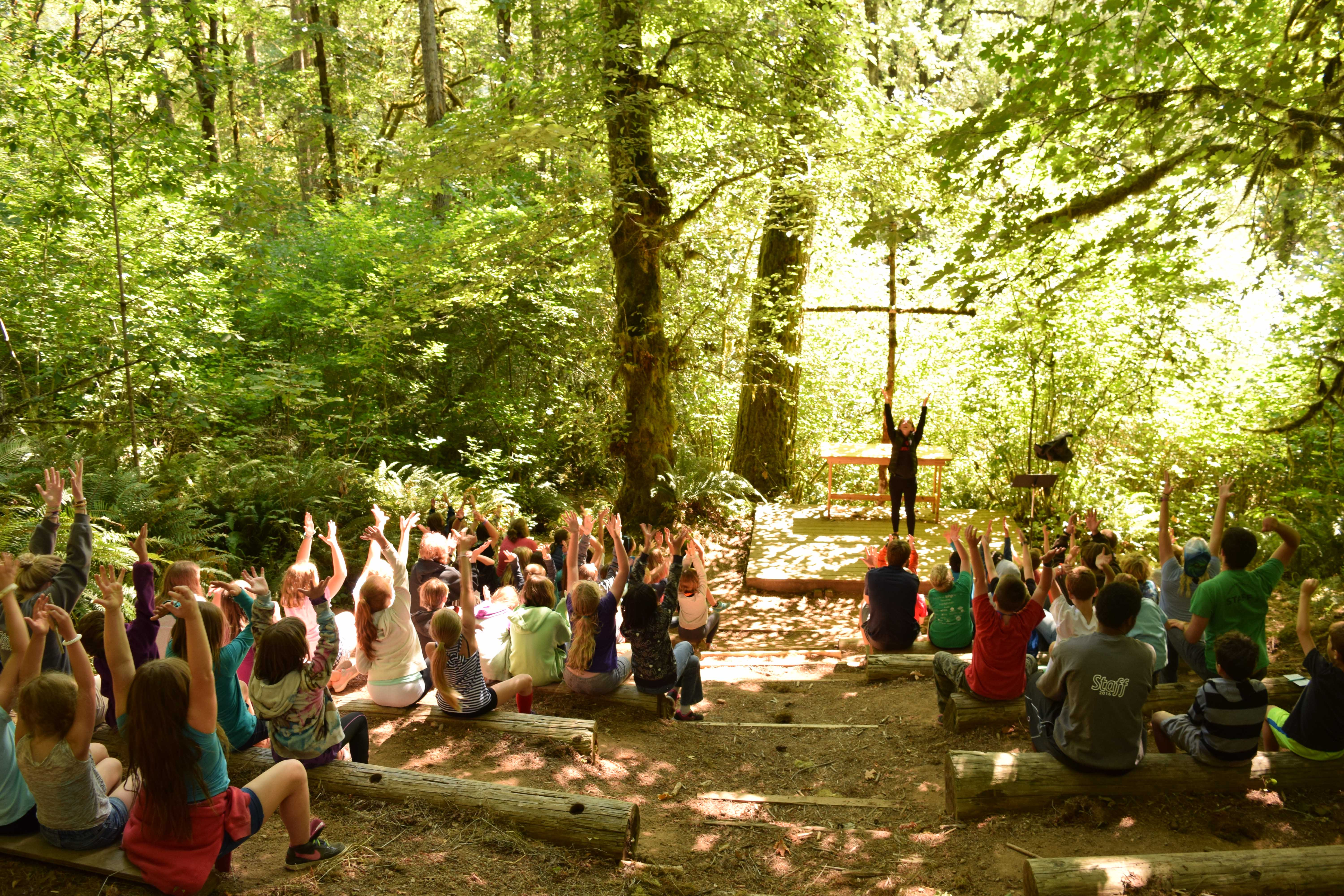 Campers and staff sing songs at Outdoor Chapel
